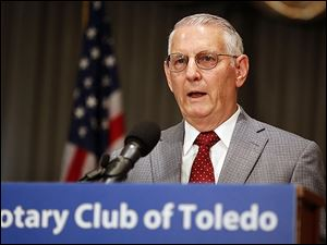 J. Winston Porter, an assistant administrator with the EPA during the Reagan years, said regulators should move slowly on global warming. He spoke to the Toledo Rotary Club on Monday.