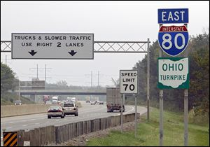 Under state law, Ohio Turnpike tolls would remain frozen at current levels for commuters using E-Z Pass and traveling less than 30 miles between exits.