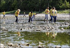 Volunteers from Toledo ZooTeens, in conjunction with Partners for Clean Streams, search the Maumee River last year to remove old lures that are made of lead.
