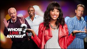 Aisha Tyler, front, succeeds Drew Carey as host of the new installment of 'Whose Line Is It Anyway,' on The CW network. Returning as improv performers will be, back from left, Colin Mochrie, Wayne Brady, and Ryan Stiles.
