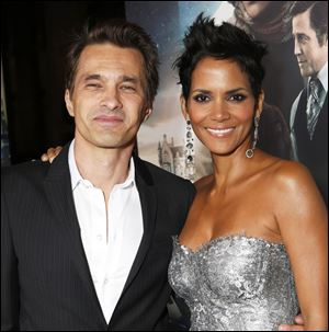 Actors Olivier Martinez and Halle Berry, photographed in October at the Los Angeles premiere of Berry's film  'Cloud Atlas,' were married in a weekend ceremony in a church near a chateau in France's Burgundy region.