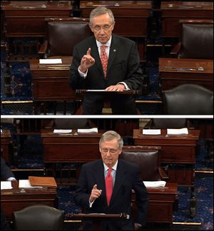 Senate Majority Leader Harry Reid, D-Nev., top, and Republican leader, Sen. Mitch McConnell, R-Ky., speak on the floor of the Senate on Capitol Hill in Washington in June.