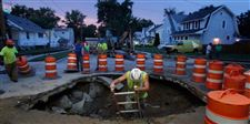 CTY-waterbreak15-worker-climbs-out-of-hole