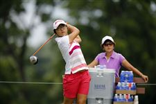 Lydia-Ko-tees-off-under-the-watchful-eye-of