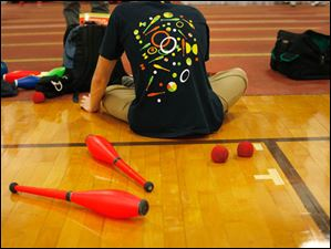 Clubs and juggling balls lie on the ground during the 66th Annual International Jugglers'€™ Association Festival on the campus of Bowling Green State University.