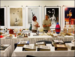 Cleveland residents Sue and Bob Durante look over a room full of juggling memorabilia.