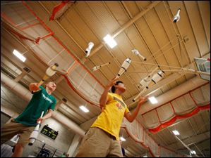 Edin, Minn. residents Sean Carnet, 20, left and Brenden Ying, 20, practice juggling 14 clubs.