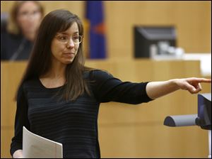 Jodi Arias points to her family as a reason for the jury to give her a life in prison sentence instead of the death penalty, during the penalty phase of her murder trial at Maricopa County Superior Court in Phoenix in May.
