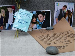 Photographs and notes are placed at a memorial for Canadian actor Cory Monteith outside the Fairmont Pacific Rim Hotel in Vancouver, British Columbia.