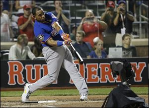 American League's Yoenis Cespedes, of the Oakland Athletics, hits his ninth home run in the third round to win the MLB All-Star baseball Home Run Derby.