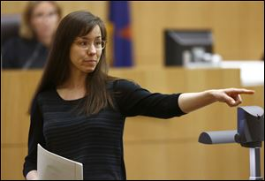 Jodi Arias points to her family as a reason for the jury to give her a life in prison sentence instead of the death penalty, during the penalty phase of her murder trial at Maricopa County Superior Court in Phoenix.