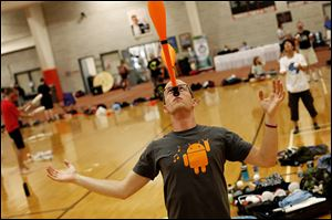 John Gunderman of Los Angeles balances clubs on his nose during the 66th annual International Jugglers' Association Festival at Bowling Green State University.
