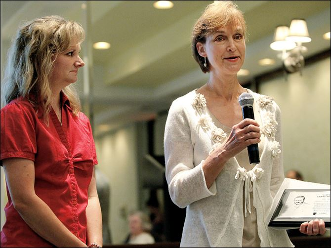 n4honor Cheryl Kazmierczak, right, with her daughter Christina Smith, accept the emergency medicine Wall of Honor award for her husband, Dr. Gary Crawford, who died in 2001. The event at UTMC was Tuesday.