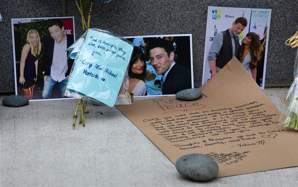 Photographs-and-notes-are-placed-at-a-memorial-f