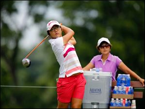 Lydia Ko tees off on Hole 5 under the watchful eye of her mother Tina Ko during a practice round.