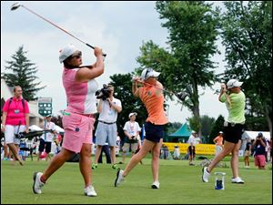 LPGA pros Christina Kim, left, Morgan Pressel, and Brittany Lincicome, right, tee off on 10 during the The Image Group Celebrity/Pro Challenge at the Marathon Classic at Highland Meadows Golf Club Tuesday.