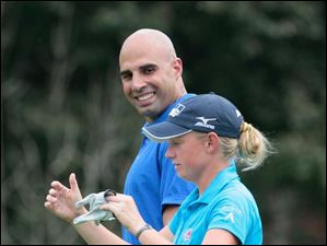 Former UT star and Pittsburgh Steelers quarterback Bruce Gradkowski jokes with LPGA pro Stacy Lewis during the The Image Group Celebrity/Pro Challenge.