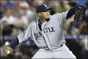 American League's Felix Hernandez, of the Seattle Mariners, pitches during the fourth inning.