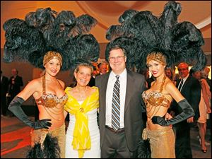 Tami Rockwell and Chris Knox, center, pose with Hollywood Casino showgirls natalie Cooper, left, and rae Anna during the gala.