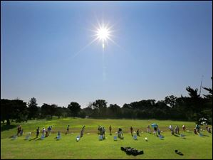 LPGA pros hit the driving range under a blazing sun during the Fathead Celebrity Pro-Am at the Marathon Classic.