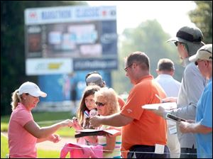 Kristy McPherson signs autographs during the Fathead Celebrity Pro-Am Wednesday.