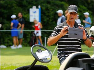 Former Detroit Red Wing Chris Chelios tries to get some music pumping for his team during the Fathead Celebrity Pro-Am at Highland Meadows Golf Club.