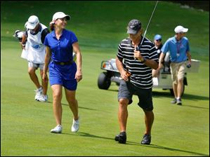 LPGA pro Paige MacKenzie chats with former Detroit Red Wing Chris Chelios during the Fathead Celebrity Pro-Am.