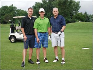 Nate Strong, Mark Tooman,  Bill Rhodus (Mark was on the committee) at the Tenth Annual Savage Foundation Golf Classic.