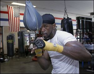 Boxer and former gang member Paul Parker works out at the Glass City Boxing gym in Toledo.