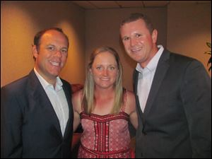 Former Toledoan and LPGA golfer Stacy Lewis, center, along with her boyfriend Stephen Cornillie, right, chat with gala entertainer, comedian Tom Papa, left.