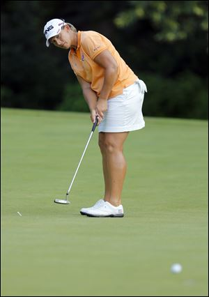 Angela Stanford sinks a birdie on No. 14 during the Fathead Celebrity Pro-Am on Wednesday at Highland Meadows Golf Club.