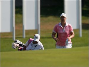 Brittany Lincicome, right, with her caddy, left, approaching the green of the ninth hole.