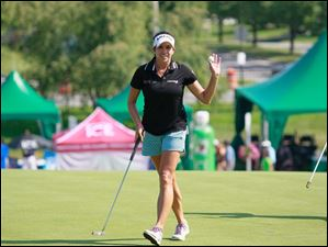 Gerina Piller acknowledges the applasue after her play at the ninth hole.
