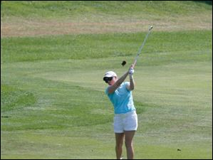 Morgan Pressel drives from the fairway on the ninth hole.