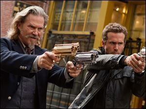 "Jeff Bridges, left, and Ryan Reynolds in a scene from ""R.I.P.D."""