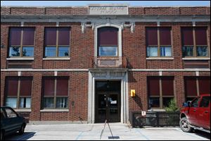 The shuttered Central Elementary School auction began Thursday.