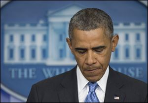 President Barack Obama pauses as he speaks about the fatal shooting of Trayvon Martin by George Zimmerman. The president made a surprise appearance today during the daily news briefing at the White House in Washington.