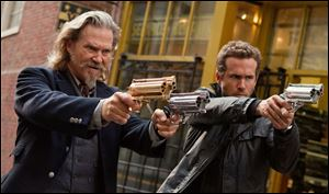 Jeff Bridges, left, and Ryan Reynolds in a scene from