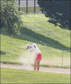 Paula Creamer hits out of a bunker on the fairway of the ninth hole in the second round of the Marathon Classic today.