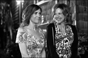 Kristen Wiig, left, and Annette Bening in a scene from 'Girl Most Likely.'