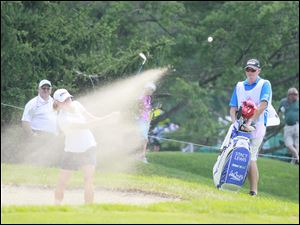 Stacy Lewis hitting out of the bunker n the ninth hole. She double boogied the hole.