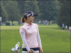 Defending champion Se Yeon Ryu reacts to missing a putt for birdie on the 18th hole.