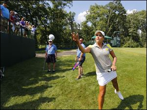 Mariajo Uribe tosses a ball to fans on 14.
