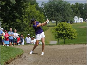 Alison Walshe hits out of the bunker on 1 during the third round of the Marathon Classic at Highland Meadows Golf Club in Sylvania, Saturday.