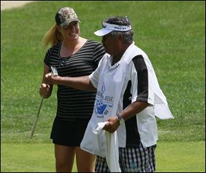 Jessica Shepley with her caddie, 'Bully' Duarte, shortly after he participated in a caddie race at the 14th hole. Duarte turned 67 on Sunday.