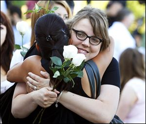 Jasmine Christman, left, is comforted by