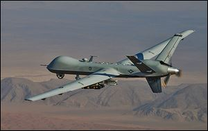 An MQ-9 Reaper, with laser-guided munitions and Hellfire missiles, soars over Afghanistan.The Pentagon has gathered more than 400 drones in a decade.