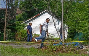 East Cleveland police search near where the bodies of three women were found. The search ended Sunday without finding more. It is not expected to resume today. A 35-year-old registered sex offender is in custody.