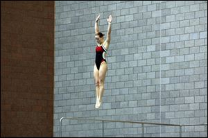 Cheyenne Cousineau, a Bedford High School graduate, prepares to dive in a meet for Ohio State University.