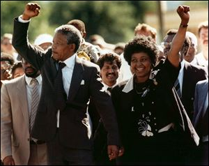 Nelson Mandela went free on Feb. 11, 1990, after  27 years as a political prisoner in South Africa. He then negotiated with the nation's apartheid oppressors to launch the country's first democratic elections in 1994. At right is his wife Winnie. The couple separated in 1992 and divorced in 1996.